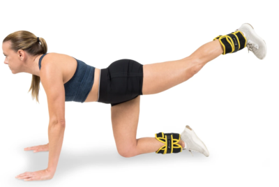 woman doing hip extensions on all fours with 15 pound adjustable ankle weight